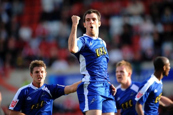 Millwall's Danny Schofield celebrates scoring against Swindon Town