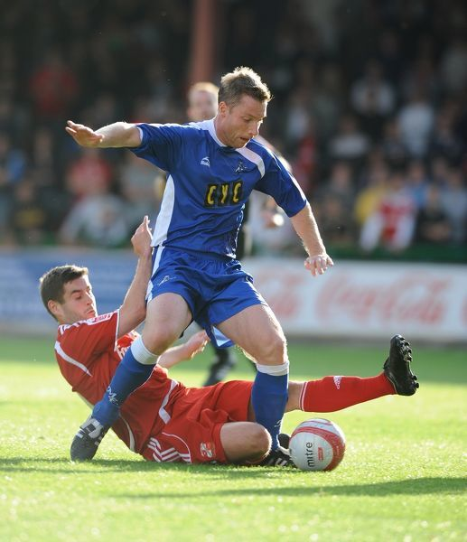 Swindon Town's Michael Timlin tackles and Millwall's Neil Harris
