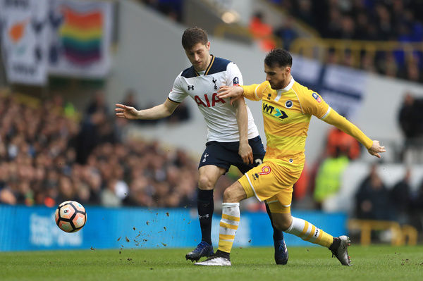 Tottenham Hotspur's Ben Davies (left) and Millwall's Lee Gregory battle for the ball during the Emirates FA Cup, Quarter Final match at White Hart Lane, London