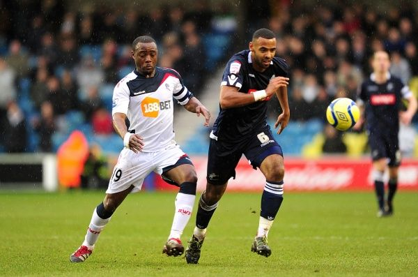 Bolton Wanderers' Nigel Reo-Coker (left) and Millwall's Liam Trotter battle for the ball