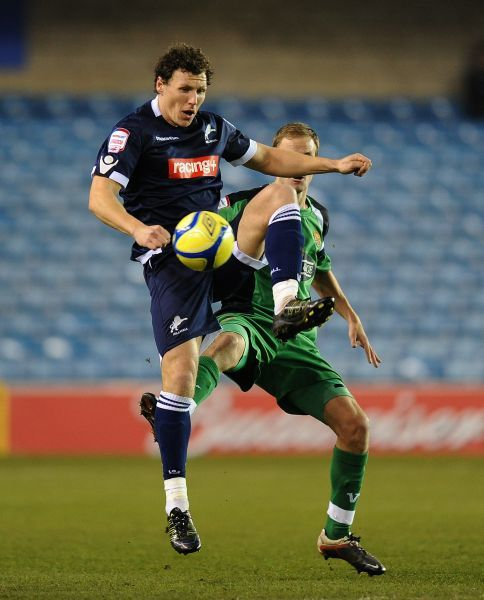 Millwall's Darius Henderson (left) and Dagenham & Redbridge's Scott Doe in action