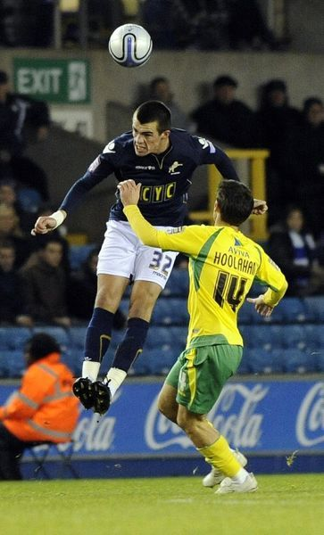 Millwall's John Marquis and Norwich City's Wesley Hoolahan during the npower Championship match at The New Den, London