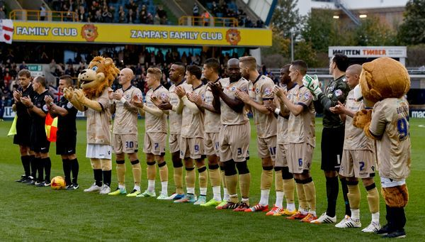 Millwall team before the start of the match wearing their special Remembrance Day shirts during the Sky Bet Championship match at The Den, London
