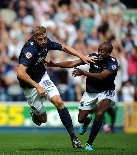 Millwall's Mark Beevers (left) is congratulated by Millwall's Nadjim Abdou (right) after scoring the opening goal of the game during the Sky Bet Championship match at the New Den, London