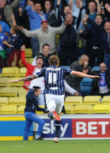 Millwall's Martyn Woolford celebrates scoring his side's first goal of the game during the Sky Bet Championship match at The New Den, London