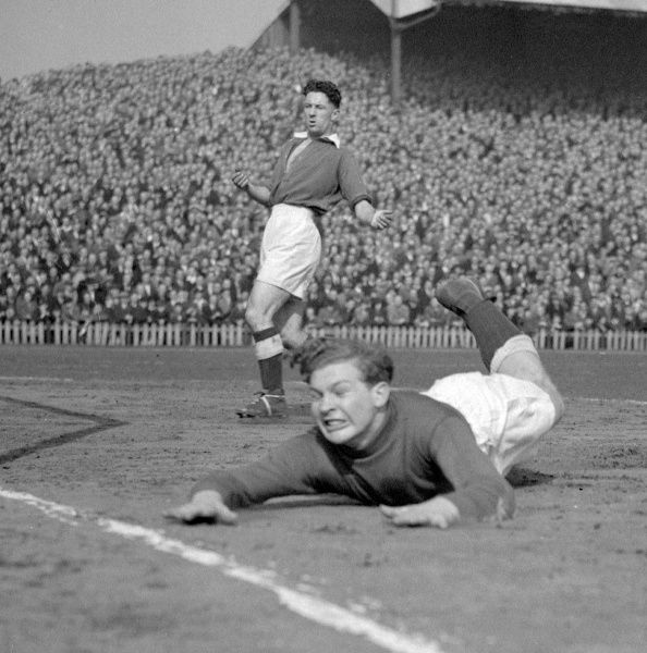 Millwall goalkeeper Malcolm Finlayson comes down to earth as he makes a save