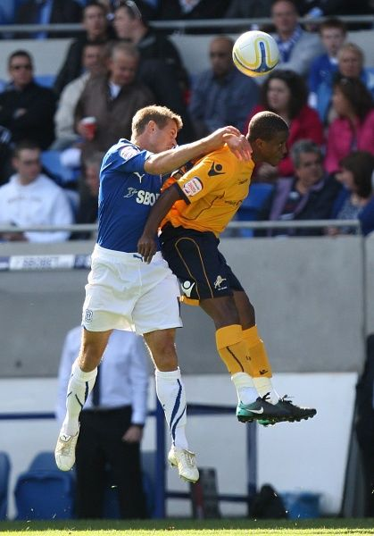 Millwall's Kevin Lisbie (right) and Cardiff's Stephen McPhail (left) battle for the ball in the air