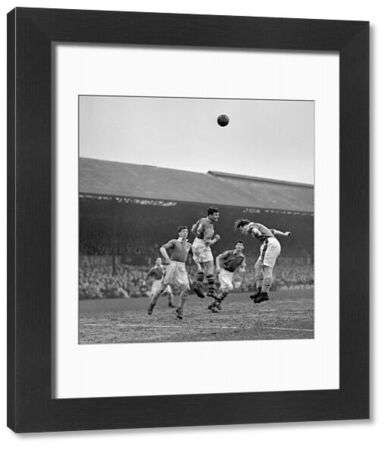 A Millwall player goes for ball during a melee round the Crystal Palace goal