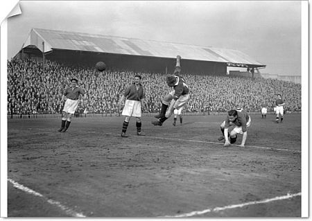 Ron Mansfield, Millwall, takes a flying header at the Plymouth goal, with Paddy Ratcliffe, the Plymouth right back beaten on the ground, right