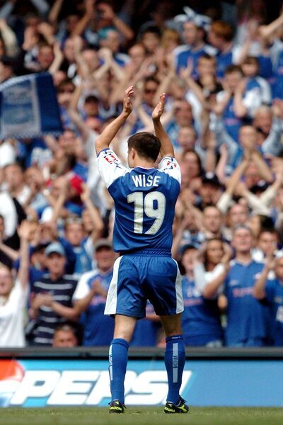 Millwall player/manager Dennis Wise thanks the fans as he leaves the pitch after being substituted