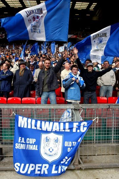 Millwall fans wave their flags in support their team