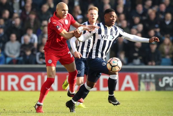 Leicester City's Yohan Benalouane and Millwall's Fred Onyedinma battle for the ball during the Emirates FA Cup, Fifth Round match at The Den, Millwall
