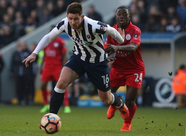 Leicester City's Nampalys Mendy and Millwall's Calum Butcher (left) battle for the ball during the Emirates FA Cup, Fifth Round match at The Den, Millwall