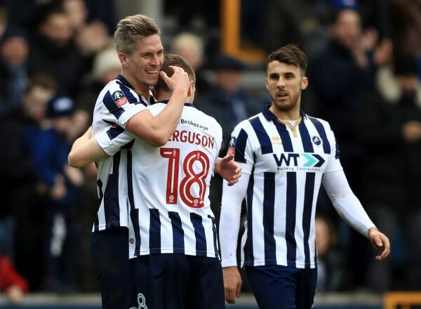 Millwall's Steve Morison celebrates scoring his side's first goal of the game during the Emirates FA Cup, Fourth Round match at The Den, London