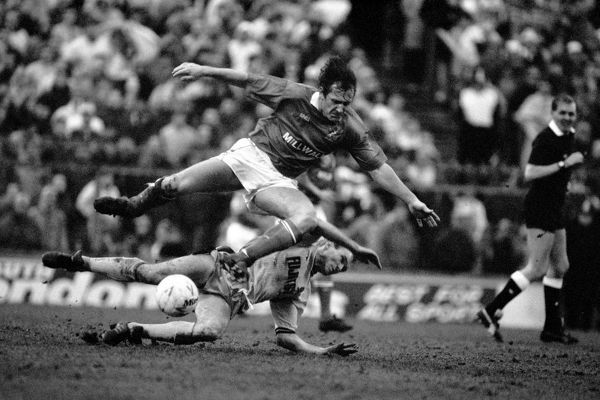 Millwall's Terry Hurlock is tackled by Cambridge United's Colin Bailey (bottom)