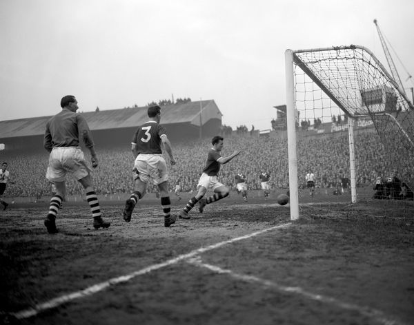 Birmingham City goalkeeper Gil Merrick (left) and left back Kenneth Green (No.3), watch helplessly as their centre half Smith chases the ball in a vain attempt to stop it crossing the goal line