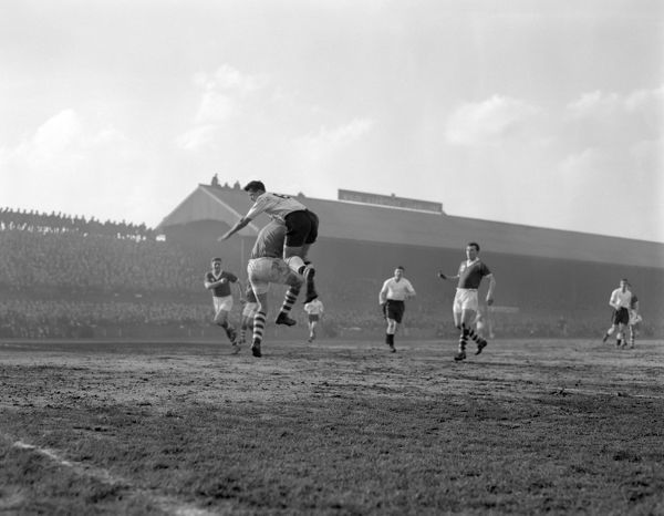 A mid-air collision between Millwall centre forward Stan Anslow, right, and Birmingham City goalkeeper Gil Merrick