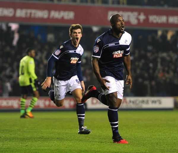 Millwall's Danny Shittu (right) celebrates after scoring his team's opening goal
