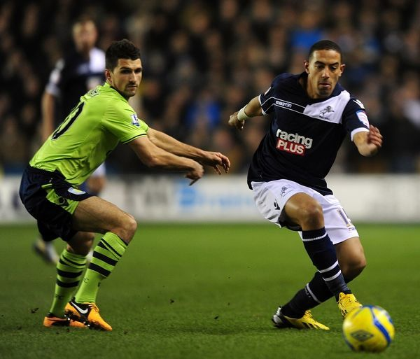 Millwall's Liam Feeney (right) and Aston Villa's Eric Lichaj battle for the ball
