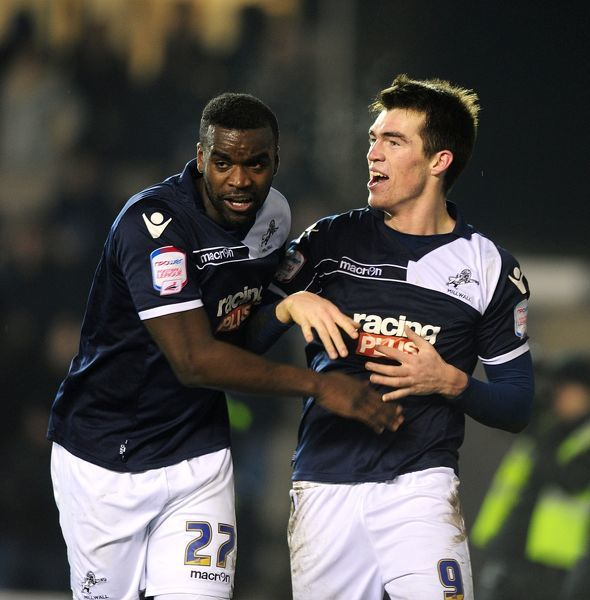 Millwall's John Marquis (right) celebrates with his team-mate Karleigh Osborne (left) after scoring his team's second goal
