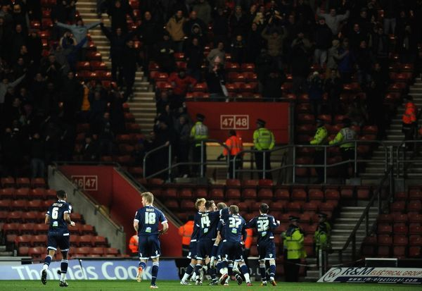 Millwall's players celebrates scoring their third goal minutes before full time