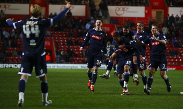 Millwall's Liam Feeny (centre right) celebrates scoring a late winner during the FA Cup Fourth Round Replay at St Mary's Stadium, Southampton