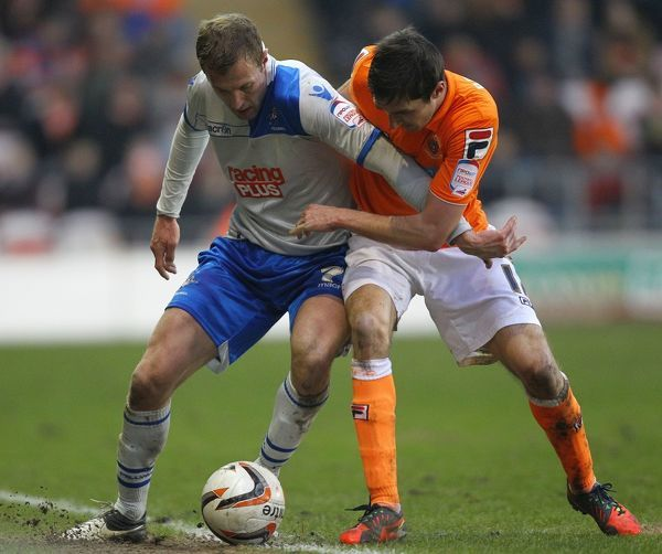 Blackpool's Chris Basham and Millwall's Rob Hulse