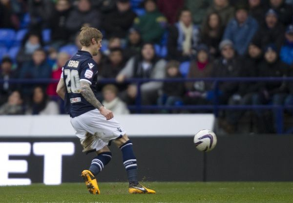 Millwall's Andy Keogh scores from the penalty spot against Bolton Wanderers