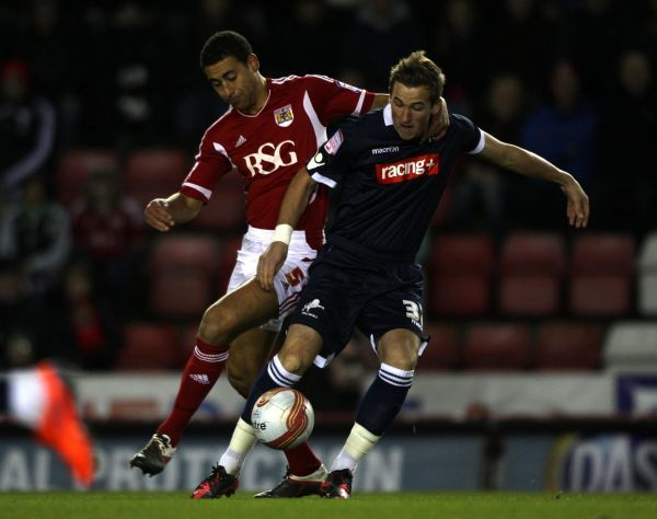 Millwall's Harry Kane shields the ball away from Bristol City defender Lewin Nyatanga during the npower Football League Championship match at Ashton Gate, Bristol