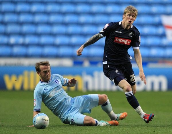 Coventry City's Sammy Clingan (left) tackles Millwall's Andy Keogh