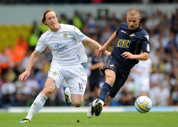 Leeds United's Luciano Becchio (left) and Millwall's Alan Dunne battle for the ball