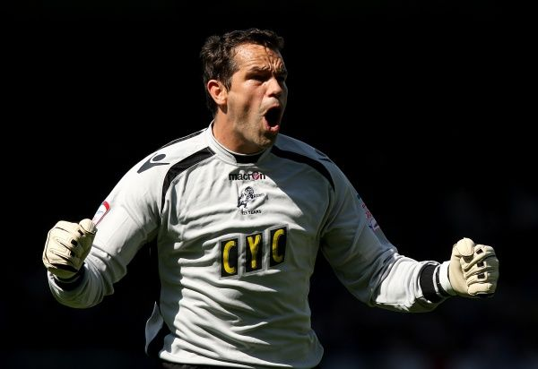 Millwall goalkeeper David Forde celebrates his side going 1-0 ahead after Leeds United's Richard Naylor scores an own goal