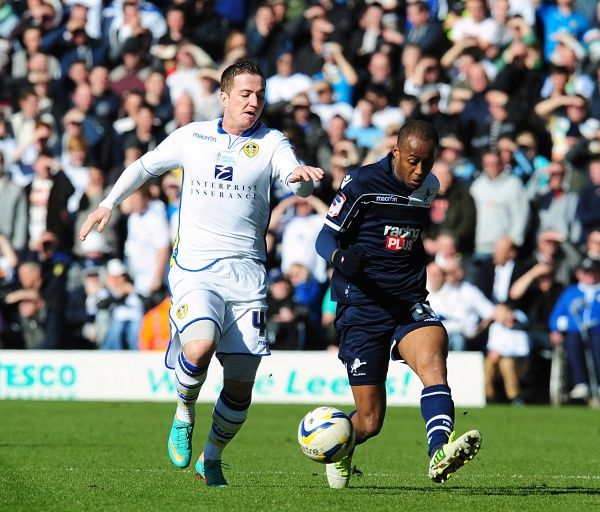 Leeds United's Ross McCormack (left) and Millwall's Nadjim Abdou (right) battle for the ball