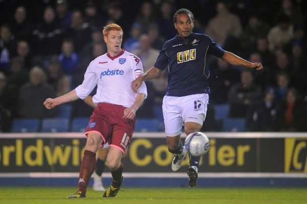 Millwall's Tamika Mkandawire and Portsmouth's Dave Kitson