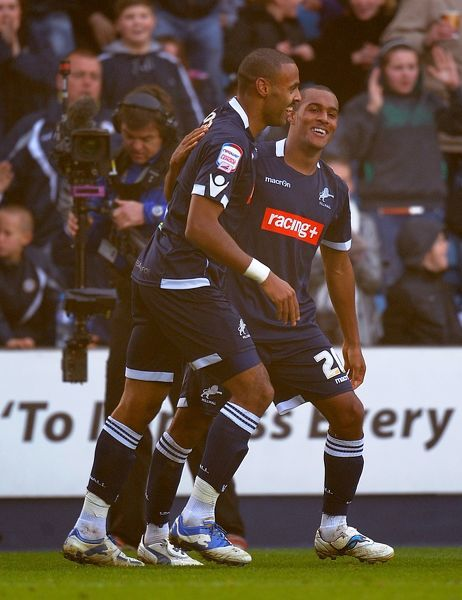 Millwall's Jay Simpson (right) is congratulated after scoring his side's equalising goal