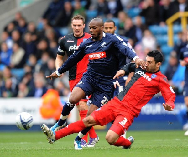 Millwall's Danny N'Guessan (left) tackled by Portsmouth's Ricardo Rocha (right)