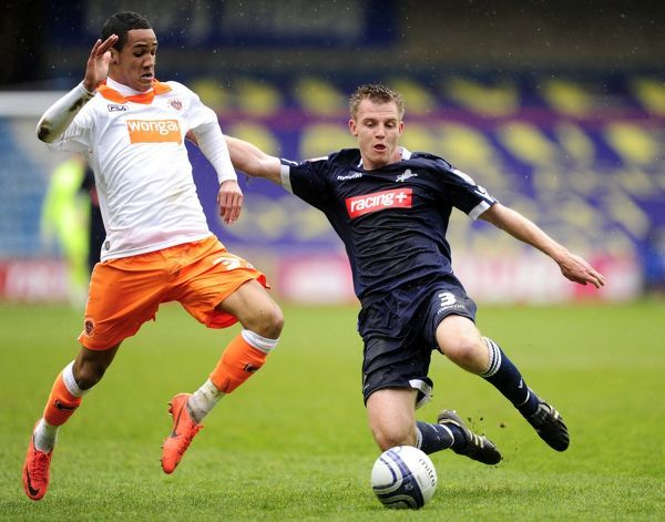 Millwall's Tony Craig and Blackpool's Thomas Ince (left) battle for the ball