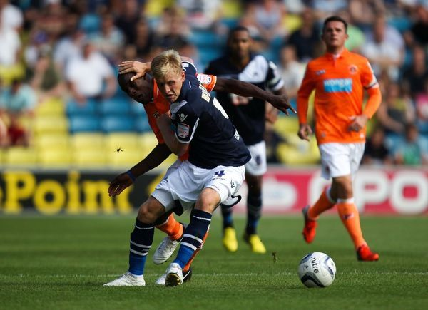 Millwall's Josh Wright battles for possession of the ball with Blackpool's Isaiah Osbourne during the npower Championship match at The Den, London