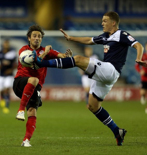 Millwall's Shane Lowry and Cardiff City's Tommy Smith (left) compete for the ball