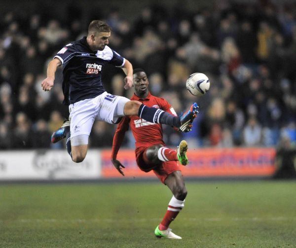 Charlton's Bradley Wright-Phillips and Millwall's Mark Beevers in action during the npower Championship match at The New Den, London