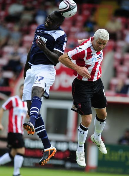 Exeter City's John O'Flynn and Millwall's Karleigh Osbourne