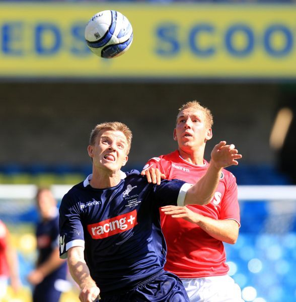 Charlton Athletic's Scott Wagstaff (right) and Millwall's Tony Craig compete for the ball