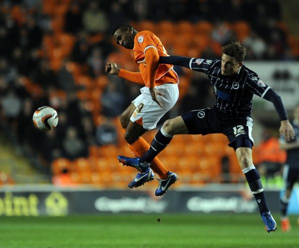 Blackpool's Ricardo Fuller (left) and Millwall's Shane Lowry battle for the ball
