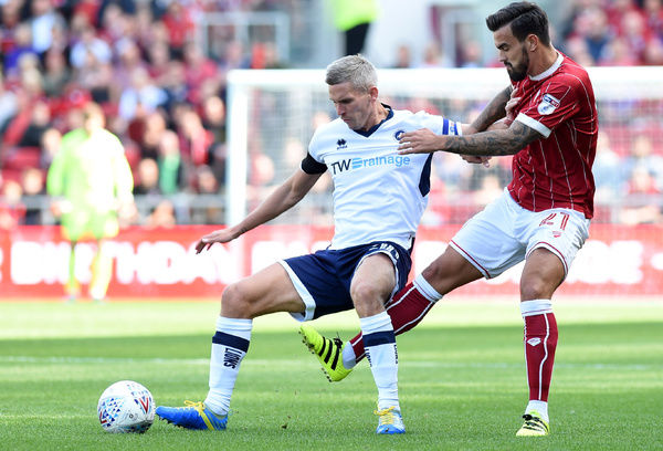 Bristol City's Marlon Pack and Millwall's Steven Morison battle for the ball