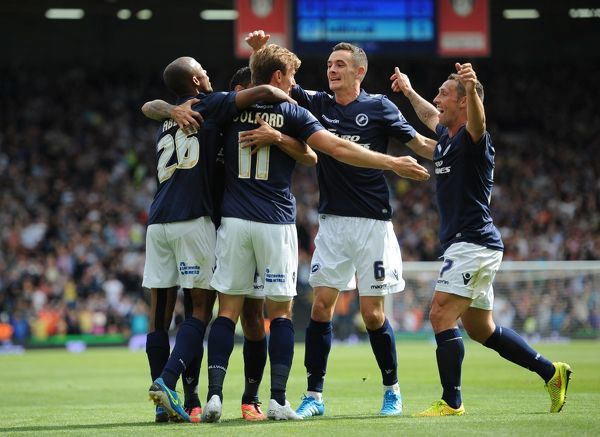 Milwall's Martyn Woolford (No11) celebrates with Nadjim Abdou (left), Shaun Williams (2nd right) and Lee Martin (right) after scoring the opening goal of the game against Fulham