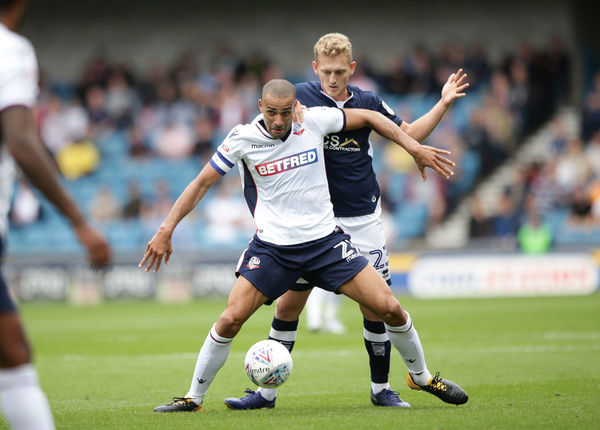 Millwall's George Saville (right) and Bolton Wanderers' Darren Pratley battle for the ball