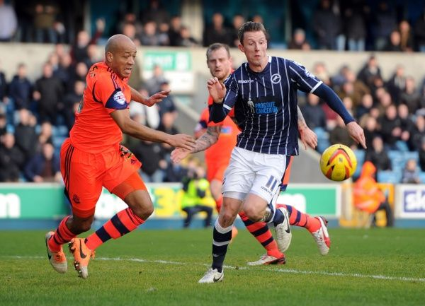 Millwall's Martyn Woolford and Bolton Wanderers' Alex Baptiste during the Sky Bet Championship match at The New Den, London