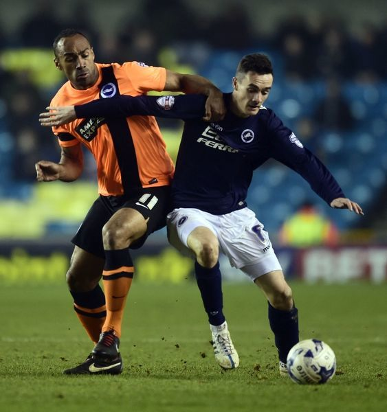 Millwall's Shaun Williams (right) and Brighton and Hove Albion's Chris O'Grady battle for the ball