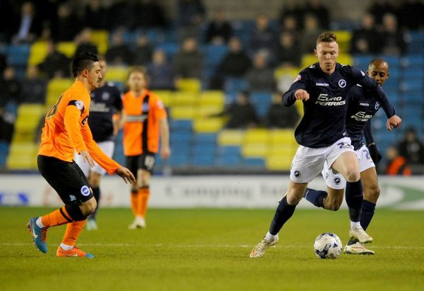 Millwall's Aiden O'Brien and Brighton and Hove Albion's Beram Kayal during the Sky Bet Championship match at The Den, London
