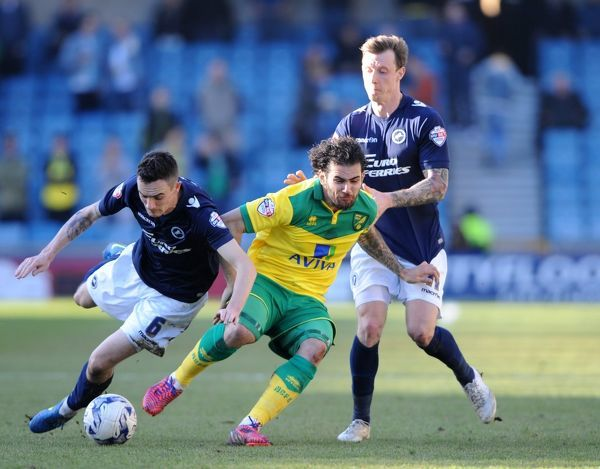 Millwall's Shaun Williams (left) and Martyn Woolford combine to stop Norwich City's Bradley Johnson